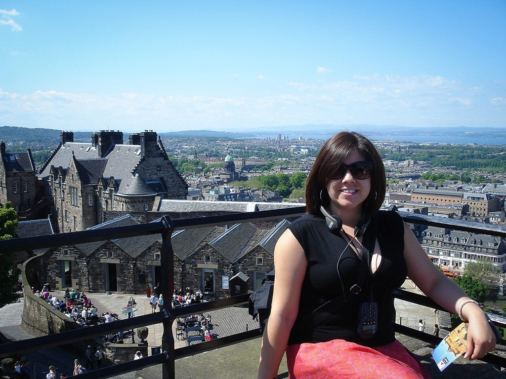 Sitting on the edge of a castle in Edinburgh, Scotland 2007