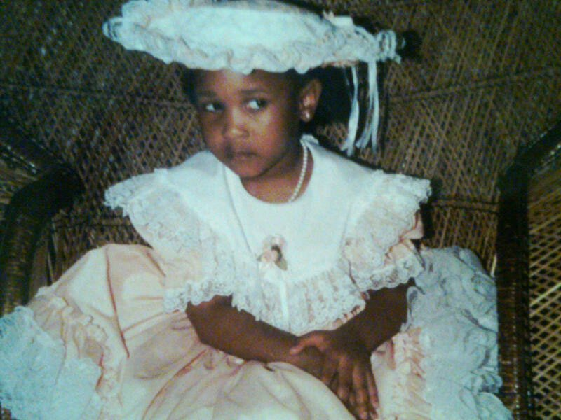 Jerria's child picture in a dress with lace.