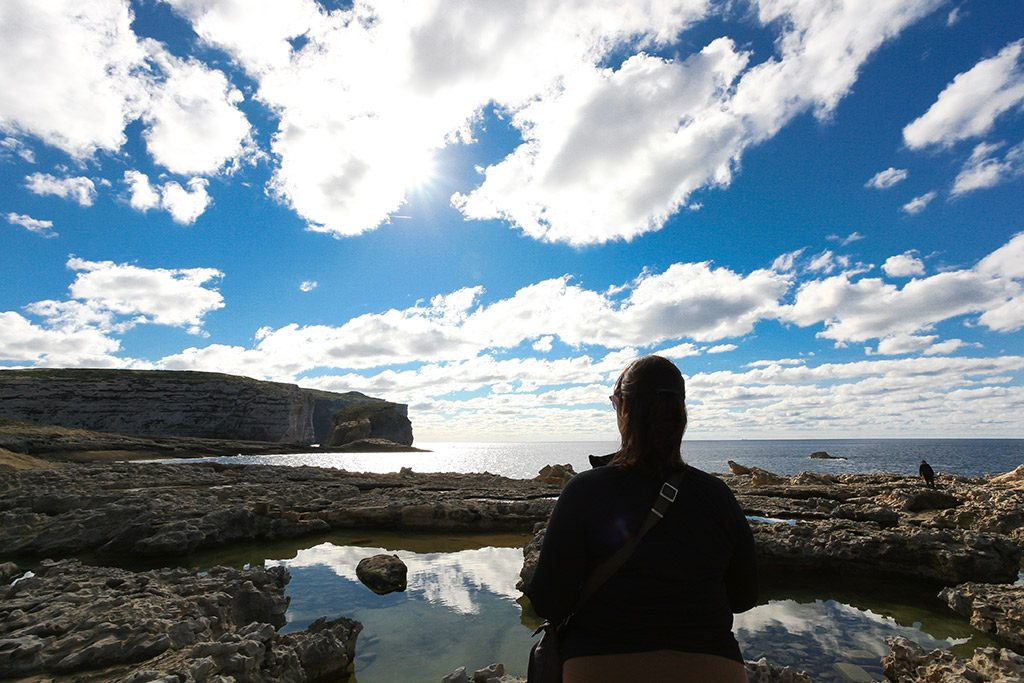 Monika looking at Fungus Rock, Gozo Malta