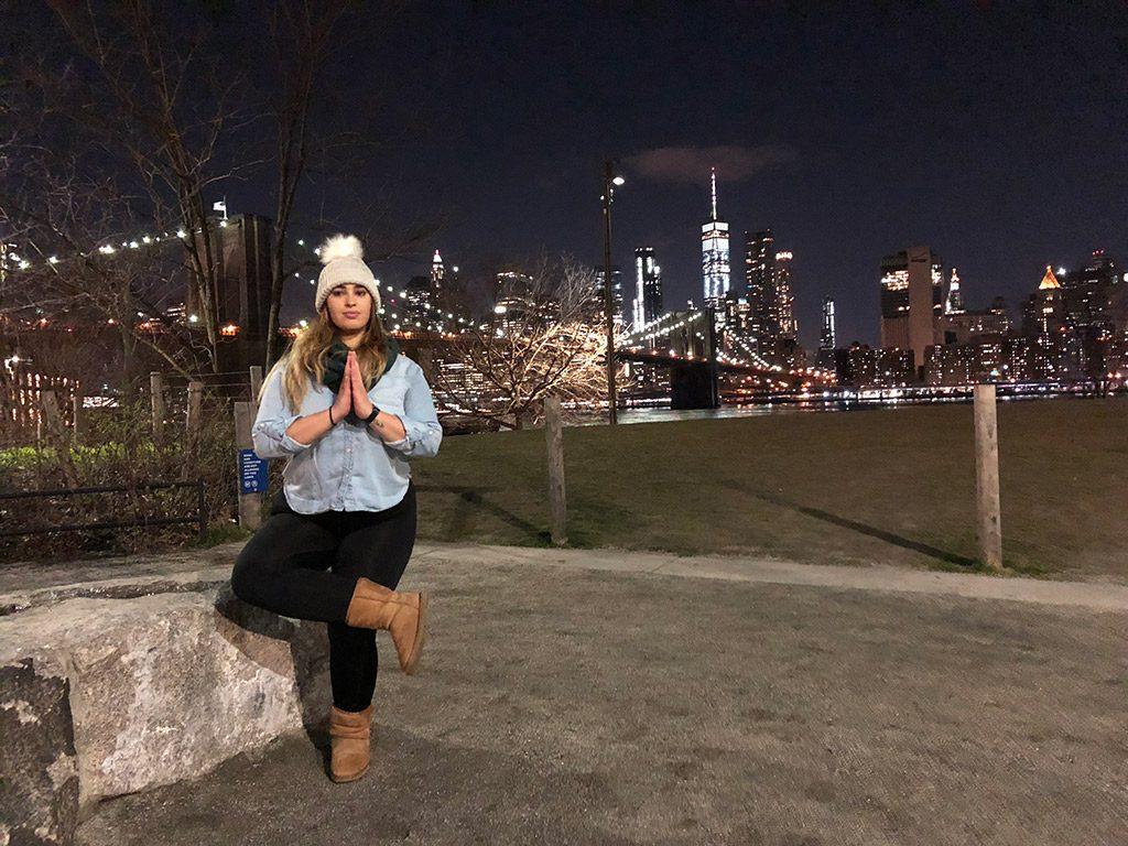 Karen with the New York lights behind her.