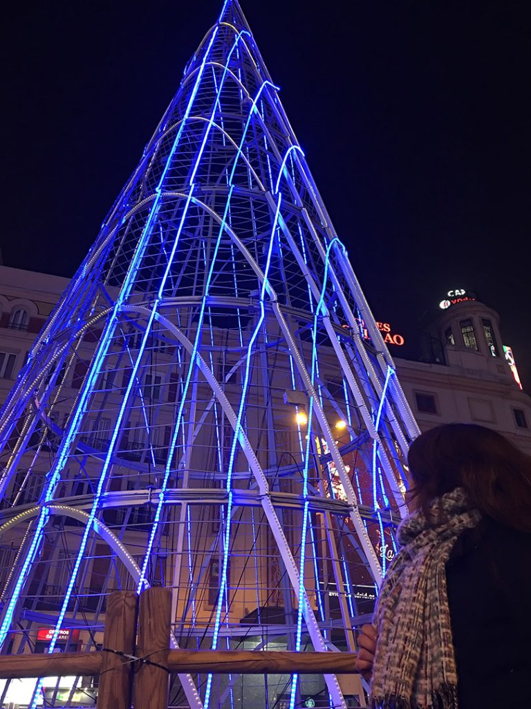 Wendie looking at the light tree in Madrid